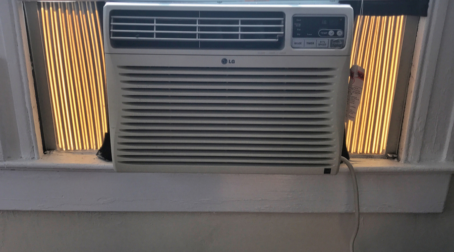 the best window air conditioner with heat installed in a small room