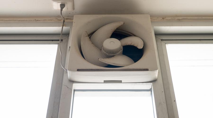 dirty window exhaust fan in bathroom