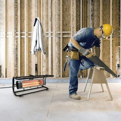 A wood worker using the best 110v garage heater