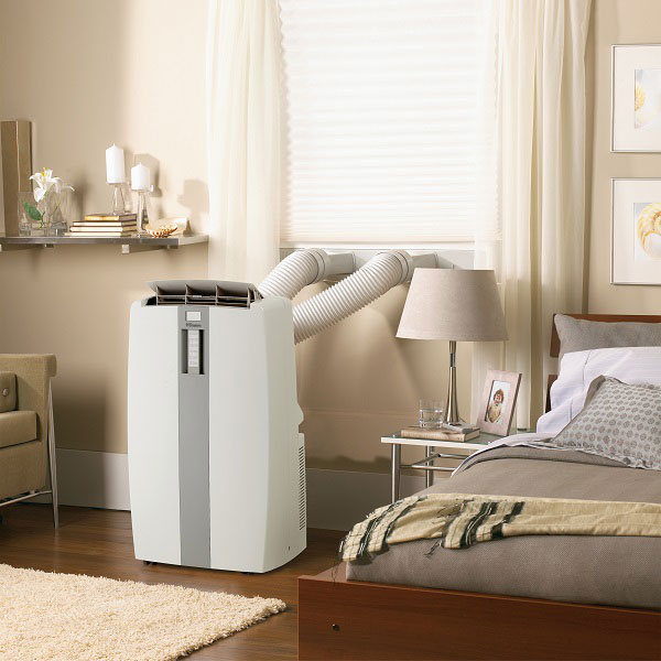 portable air conditioner under $400 installed in a bedroom